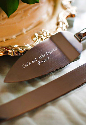 Brushed bronze cake knife and engraved cake spatula that says,